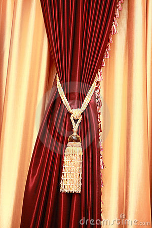 Purple velvet curtain with golden tassel