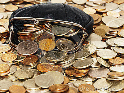 Purse with coins and dollars