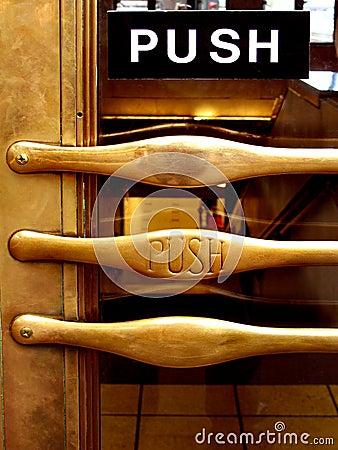 Push brass door handle