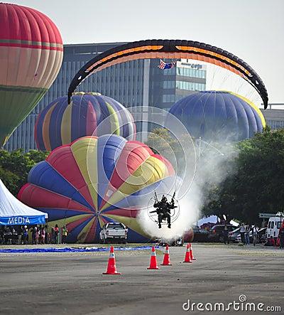 Paramotor squad flying during 5th Putrajaya International Hot Air Balloon Fiesta 2013 Editorial Stock Photo