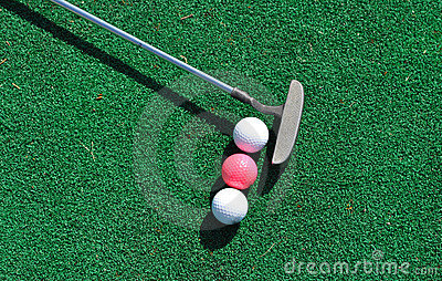 Putter and three golf balls