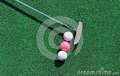 Putter and three golf balls