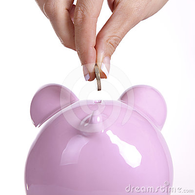 Putting coin in a piggy bank