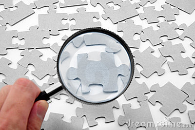 Puzzle and magnifier