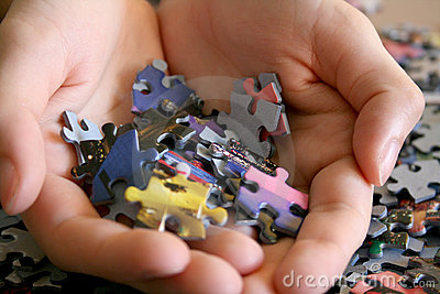 Puzzle Pieces in Hand