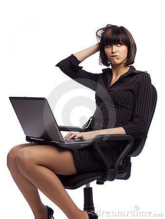 Puzzled brunette woman in dark dress sitting