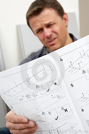 Puzzled Man Reading Assembly Furniture Instruction