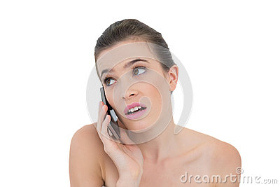 Puzzled natural brown haired model making a phone call