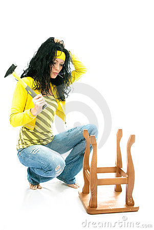 Puzzled woman repairs a chair