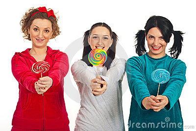 Pyjamas women giving colorful lollipops