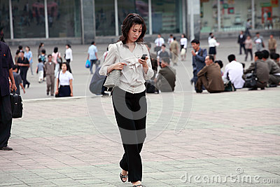 Pyongyang female with mobile phone Editorial Stock Photo