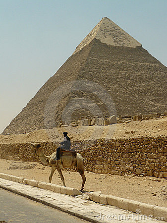 Pyramid and police guard on camel Editorial Photography