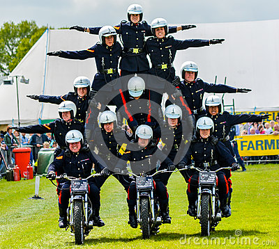 Free Pyramid Stunt Motorbike Riders Royalty Free Stock Photography - 69975727