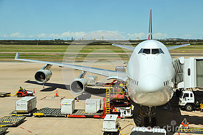 Qantas Boeing 747-400 is being loaded Editorial Stock Photo