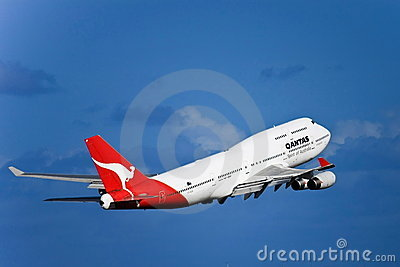 Qantas Boeing 747 jet in flight on a blue sky Editorial Stock Image
