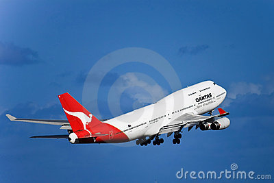 Qantas Boeing 747 jet in flight with landing gear. Editorial Photo