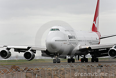 Qantas Boeing 747 jet taxis on the runway. Editorial Image