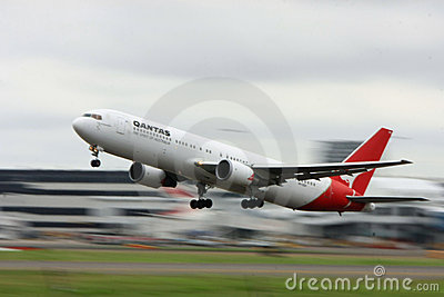 Qantas Boeing 767 with background motion blur. Editorial Photo