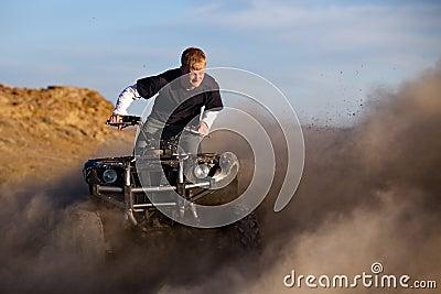 Quad ATV kicking up dust