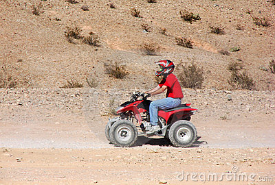 Quad ATV Rider in Desert