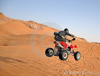 Quad bike jumping in the desert