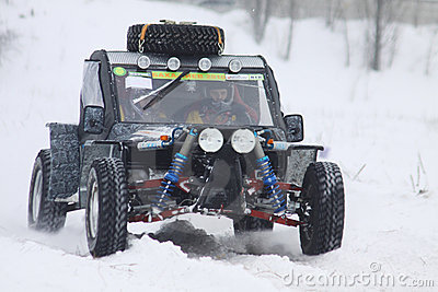 The quad bike s drivers ride over snow track Editorial Stock Photo