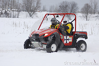 The quad bike s drivers ride over snow track Editorial Image
