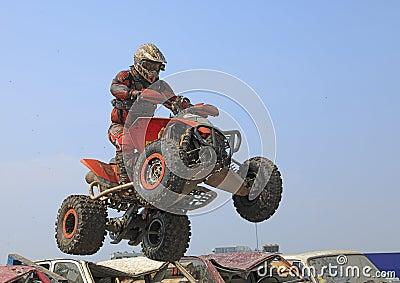 Quad jump Editorial Stock Image