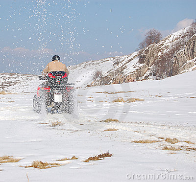 Quad throwing snow all over