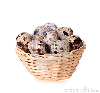 Quail eggs in a basket on the white
