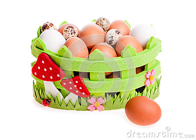 Quail eggs and chicken in green decorative basket