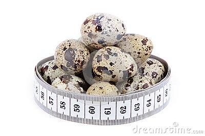Quail eggs and measuring tape