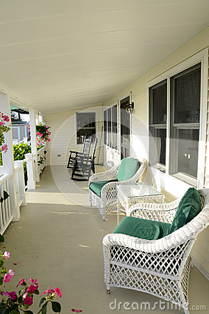 Quaint covered porch with furniture
