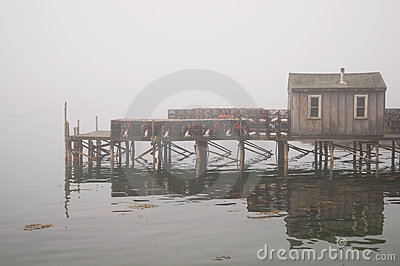 Quaint fishing wharf in fog
