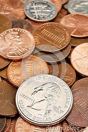 Quarter Dollar coin closeup over coins