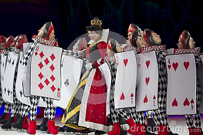 Queen Of Hearts And Card Soldiers In Line Editorial Image
