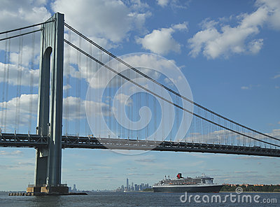 Queen Mary 2 cruise ship in New York Harbor under Verrazano Bridge heading for Transatlantic Crossing from New York to Southampton Editorial Image
