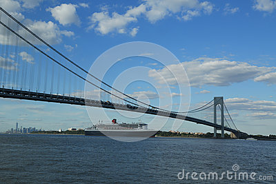 Queen Mary 2 cruise ship in New York Harbor under Verrazano Bridge heading for Transatlantic Crossing from New York to Southampton Editorial Stock Image
