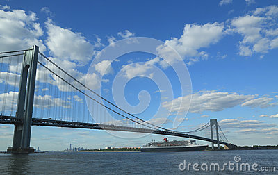 Queen Mary 2 cruise ship in New York Harbor under Verrazano Bridge heading for Transatlantic Crossing from New York to Southampton Editorial Photography