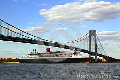 Queen Mary 2 cruise ship in New York Harbor under Verrazano Bridge heading for Transatlantic Crossing from New York to Southampton Editorial Stock Photo