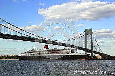 Queen Mary 2 cruise ship in New York Harbor under Verrazano Bridge heading for Transatlantic Crossing from New York to Southampton Editorial Stock Photo