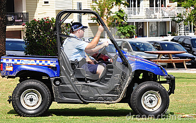 Queensland Police patrolling beach in 4wheel drive Editorial Stock Image