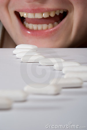 Queue of chewing gums heading to open mouth