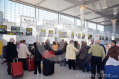 Queus at check in desks, Malaga airport. Editorial Stock Image