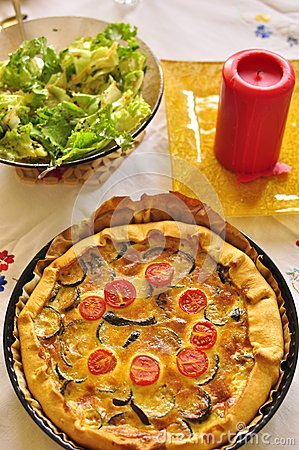 Quiche with courgette and salad