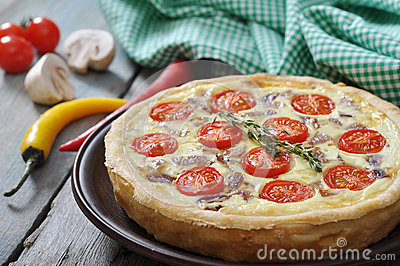 Quiche pie with chicken and cherry tomato