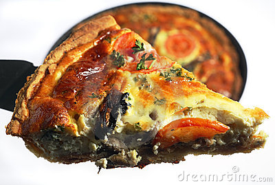 Quiche slice being lifted from a pan