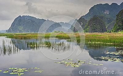 Lake near old mountains in Vietnam