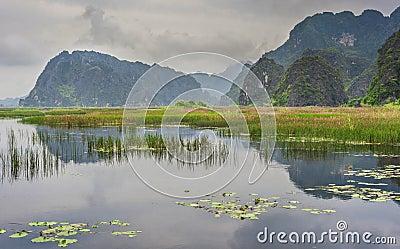 Lake near old mountains in Vietnam