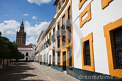 Quiet street in Seville with church bell tower